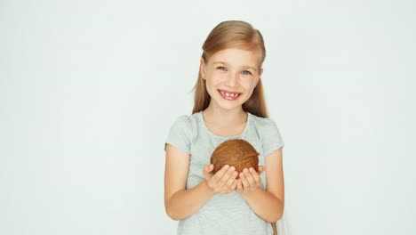Girl-Holding-And-Showing-A-Coconut-And-Laughing-At-Camera