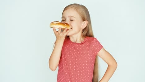 Girl-Holding-And-Sniffing-A-Cake-With-Cheese-Child-Rubs-His-Belly