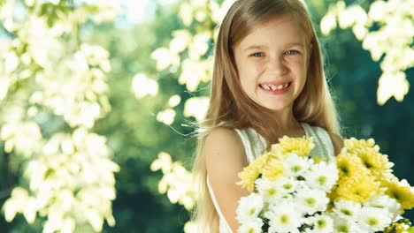 Girl-Holding-Bouquet-Of-White-And-Yellow-Flowers-And-Laughing-At-Camera