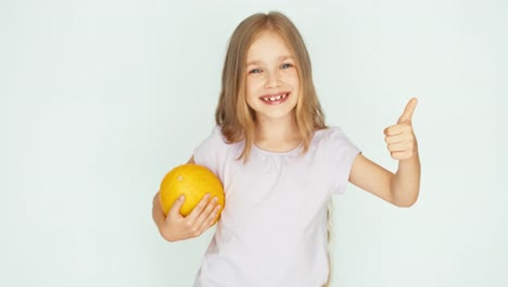 Girl-Holding-Melon-And-Playing-With-Berry-Thumb-Up-Ok