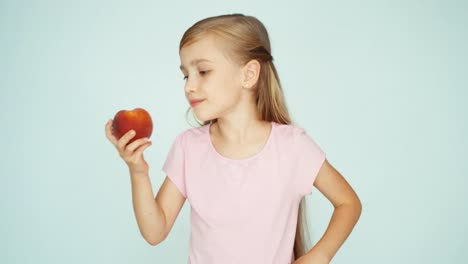 Girl-Holding-Peach-And-Kissing-It-On-The-White-Background-Thumb-Up-Ok
