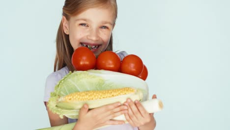 Girl-Holding-Vegetables-Cabbage-Corn-Tomato-Celery-And-Laughing-At-Camera-02