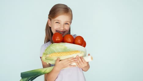 Girl-Holding-Vegetables-Cabbage-Corn-Tomato-Celery-And-Laughing-At-Camera-01
