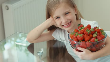 Girl-Hugging-Big-Plate-Of-Strawberries-And-Laughing-At-Camera-Panning