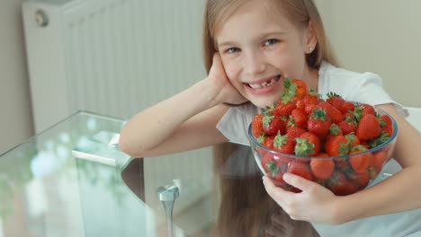 Girl-Hugging-Big-Plate-Of-Strawberries-And-Laughing-At-Camera