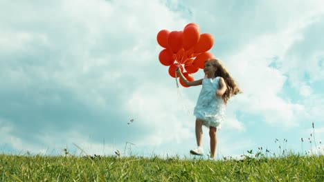 Girl-In-A-White-Dress-Holding-Red-Balloons-And-Walking-On-A-Green-Grass-02