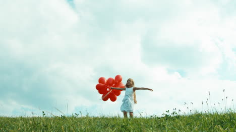 Girl-In-A-White-Dress-Holding-Red-Balloons-And-Whirling-Against-The-Sky-In-Ov