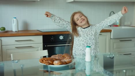 Girl-stretching-in-the-kitchen-after-waking-up