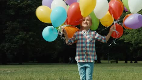 Girl-Jumping-With-Balloons-And-Spinning-And-Laughing-At-Camera