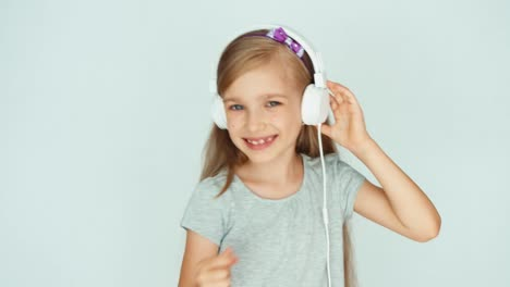 Girl-Listening-To-Music-And-Dancing-On-A-White-Background