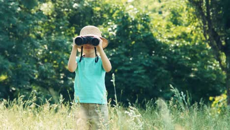 Girl-Looking-Through-Binoculars-At-Camera-And-Waving-Hand-And-Laughing-01