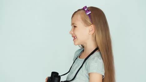 Girl-Looking-Through-Binoculars-At-Camera-Girl-Laughing-On-A-White-Background-01