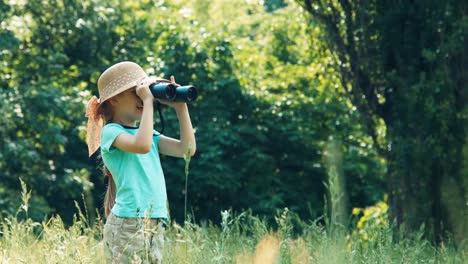 Girl-Looking-Through-Binoculars-At-Distance