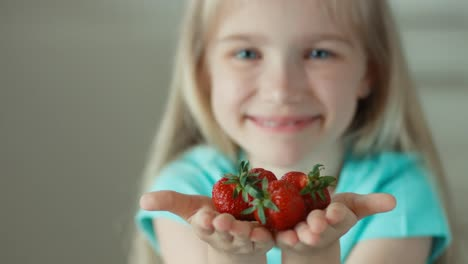 Girl-Offering-Strawberries-For-Viewers