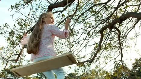 Girl-On-A-Swing-Back-At-The-Camera-Child-Turns-To-The-Camera-01
