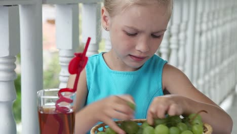 Girl-Outdoors-Child-Playing-In-The-Kids-Count-And-Then-Eats-Grapes