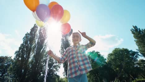 Girl-Playing-With-Balloons-Child-With-Balloons-Against-The-Sun