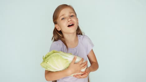 Girl-Playing-With-Cabbage-And-Singing-A-Lullaby-Child-Biting-Cabbage-02