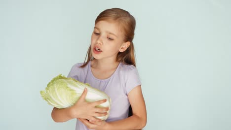 Girl-Playing-With-Cabbage-And-Singing-A-Lullaby-Niño-Biting-Cabbage-01