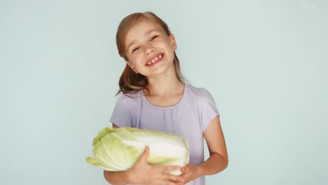 Girl-Playing-With-Cabbage-And-Singing-A-Lullaby-Thumb-Up-Ok