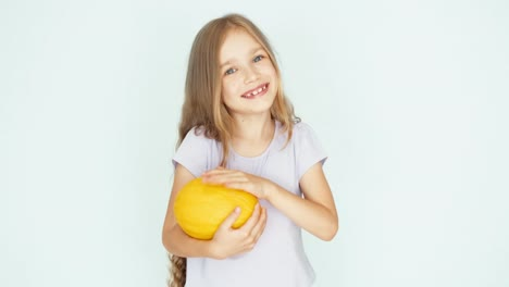 Girl-Playing-With-Melon-And-Laughing-At-Camera-On-The-White-Background-Thumb-Up