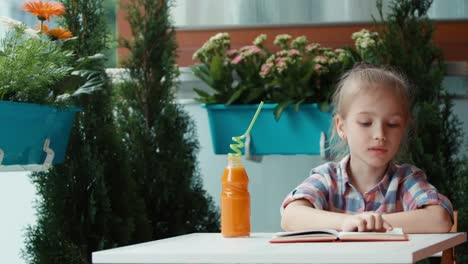 Girl-Reading-A-Book-Among-The-Flowers