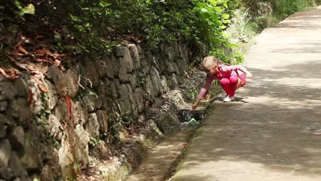 Girl-Running-Along-The-Path-With-A-Paper-Boat-In-Hand