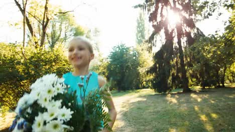 Girl-Running-With-A-Bouquet-On-A-Footpath-In-The-Park