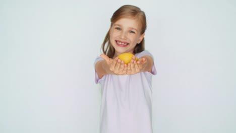 Girl-Showing-Lemon-Child-Laughing-At-Camera
