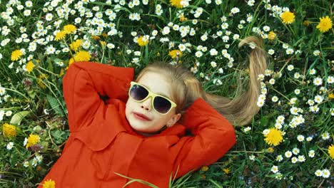Girl-Singing-A-Song-And-Laughs-Closeup-Portrait-Child-Lying-In-The-Grass