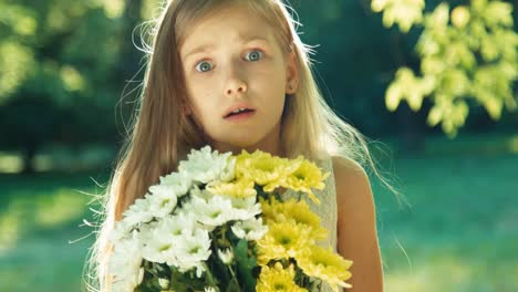 Girl-Sneezes-Because-She-Is-Sniffing-Flowers