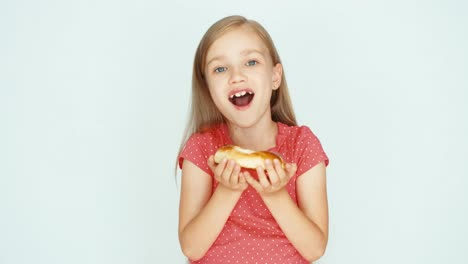 Girl-Sniffing-A-Bun-With-Cheese-And-Showing-At-Camera