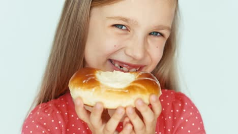 Girl-Sniffing-A-Bun-With-Cheese-Child-On-The-White-Background-Closeup