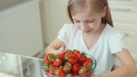 Girl-Sniffing-And-Hugging-Big-Plate-Of-Strawberries