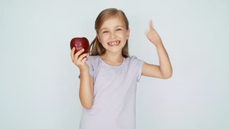 Girl-Sniffing-And-Kissing-Apple-And-Laughing-Thumb-Up-Ok