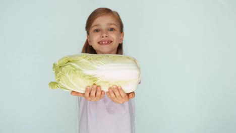 Girl-Sniffing-Cabbage-And-Showing