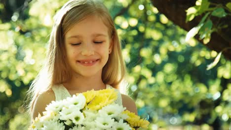 Girl-Sniffing-Flowers-And-Smiling
