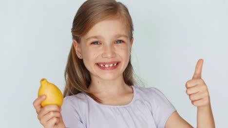 Girl-Sniffing-Lemon-And-Laughing-At-Camera-Thumb-Up-Ok-Closeup