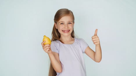 Girl-Sniffing-Lemon-And-Laughing-At-Camera-Thumb-Up-Ok