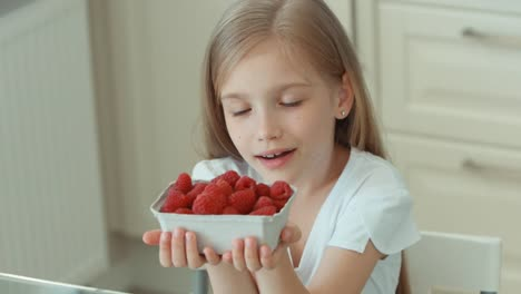 Girl-Sniffing-Raspberries-And-Gives-The-Viewer-A-Basket