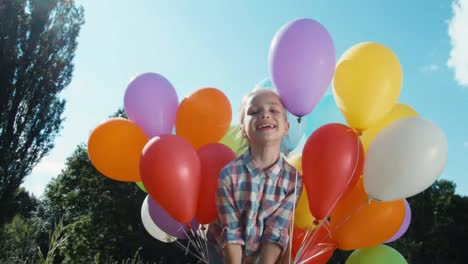 Girl-Spinning-With-Balloons-And-Child-Looking-Into-The-Camera