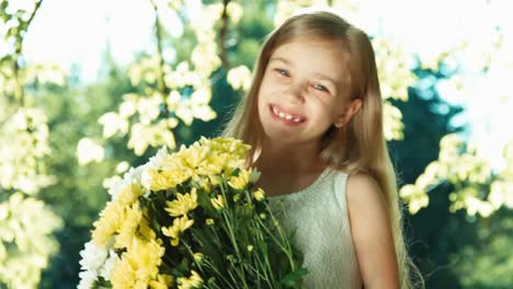 Girl-Turning-At-Camera-Child-Holding-Bouquet-Of-White-And-Yellow-Flowers