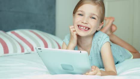 Girl-Using-Tablet-PC-And-Smiling