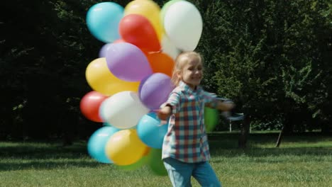 Girl-Walking-And-Spinning-With-Balloons-In-The-Meadow-At-Camera