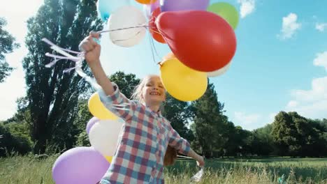 Girl-Walking-At-Camera-With-Balloons-In-The-Park