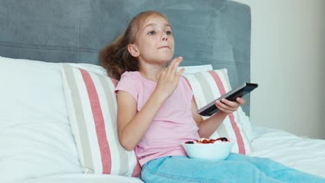 Girl-Watches-Tv-And-Eating-Sweets
