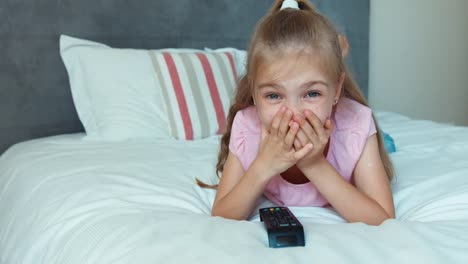 Girl-Watching-Tv-Lying-On-The-Bed-Child-Shocked-Tv
