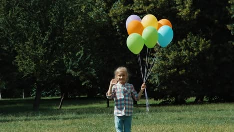 Girl-Waving-Hand-At-Camera-Laughing-Girl-Wich-Has-A-Lot-Of-Balloons-Running