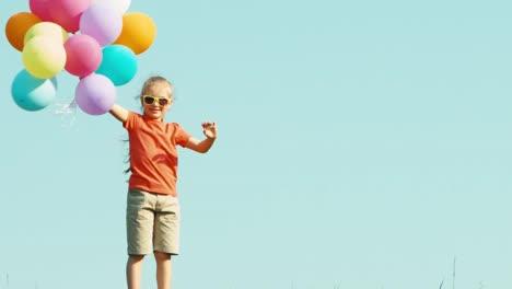 Girl-With-Balloons-Waving-Hand-At-Camera-And-Smiling