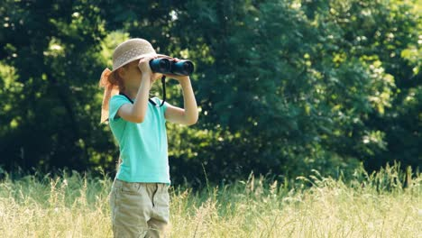 Girl-With-Binoculars-Enters-The-Frame-And-Looking-Through-Binoculars